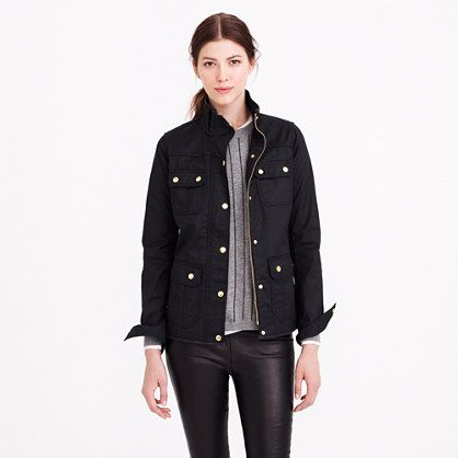 "Field jacket in black. ""In water-resistant waxed cotton with military-inspired pockets and snaps, this is our idea of standard issue."" - J. Crew."
