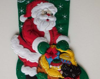 This stocking measures 18 from hanger to toe. Our Santa in Hawaii almost looks like this, except he dons an aloha shirt and comes to town on an outrigger canoe. What a great way to bring some tropical sunshine, surf and sand into your home during the holidays.    NAMER EMBROIDERED FREE OF CHARGE. Please include a name upon ordering.    Inquire about international shipping.