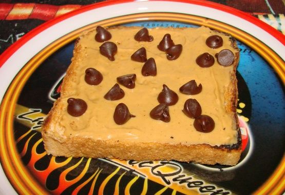 Two pieces of bread, topped with 1/2T PB and 2T Chocolate chips  So simple, its hardly a recipe, but the combination of a little chocolate and peanut butter in the morning is very satisfying. The idea for doing this came from having read about French schoolchildren often eating a piece of chocolate between pieces of bread. It wasnt far to go to add peanut butter for some protein.