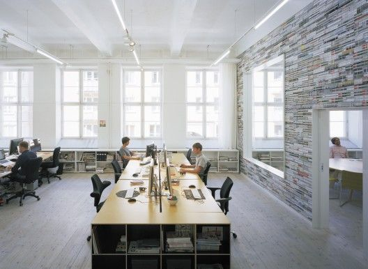 Creative workplace case study: Oktavilla- bureau for magazine design in an old textile manufacturing hall in Stockholm.