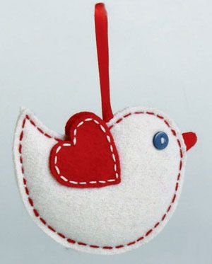 Bird Felt Ornament, by Tag. Part of the Chalet Collection. This is for the BIRD ornament, made of red and white felt, lightly stuffed, and stitched with red and white thread. Measures 3.25 x 4.25 inches. Other ornaments available!