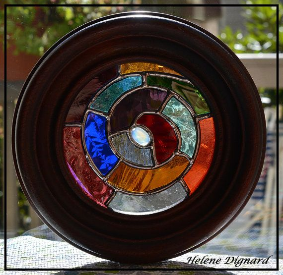 You are looking at a beautiful small Stained glass suncatcher made by using the copper foil technique.  Abstract Spiral made of colorful stained glass set in an old Victorian wood frame.  Size; the frame is 6-1/2 diameter  The item will be ship with a suction cup for hanging.  This item will be shipped via USPS in a sturdy box ! The shipping cost is $7.00.  #2