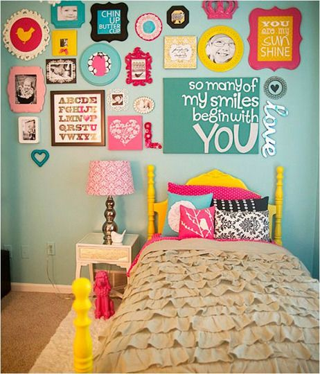 Charming whimsical frames over a little girls bed! Cute for play room with kids art work and quotes they said!