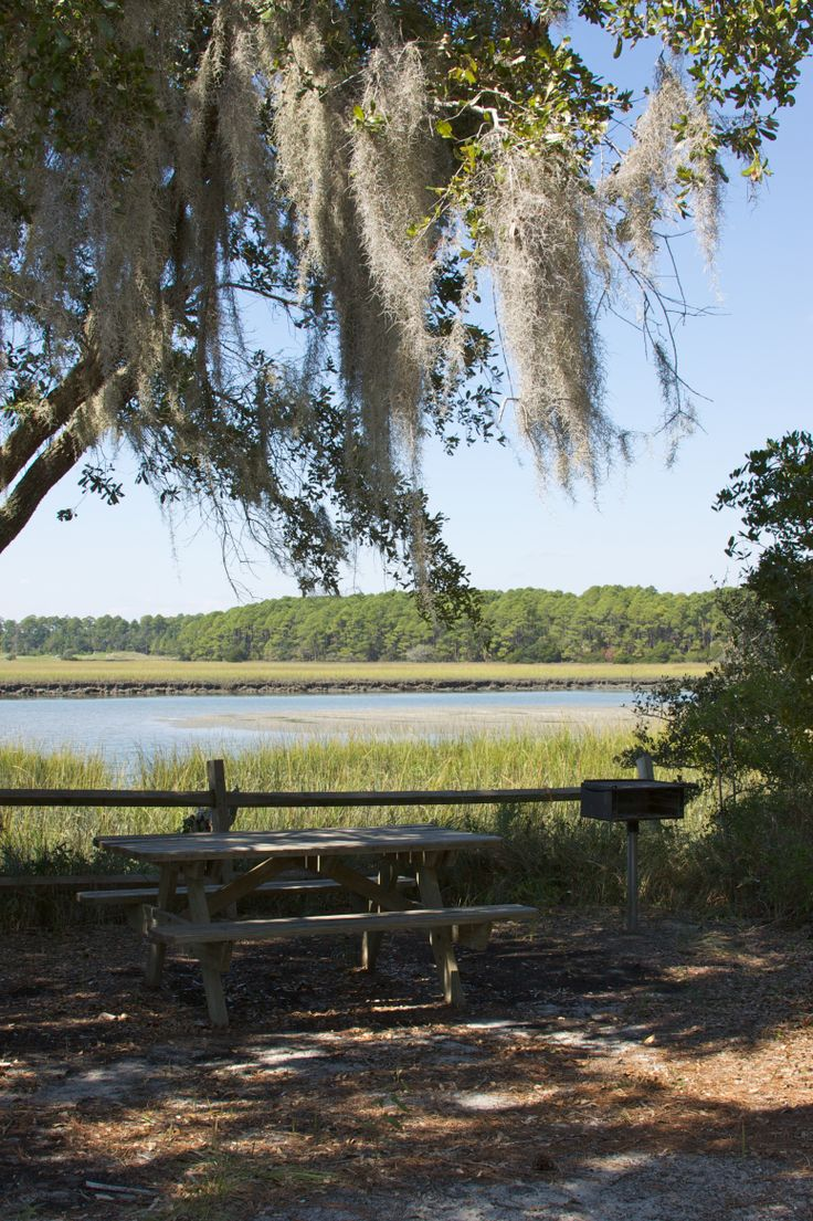Visitors to Beachwalker County Park on Kiawah Island, South Carolina, enjoy access to a shaded picnic area with grills, restrooms, outdoor showers, a snack bar, and chair and umbrella rentals.