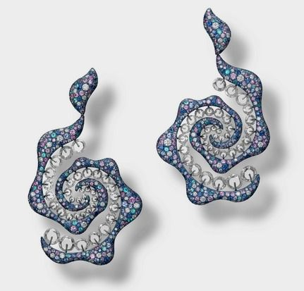 Carnet: 'Sparkling Swirl' Earrings, blue titanium pavé-set with multi-coloured sapphires including shades of blue and purple, accented with paraiba tourmalines and brilliant-cut diamonds, embellished with a contour of rondelle-cut diamonds on Symbolic & Chase