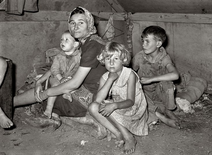 """February 1939. Mother with children at migrant camp. Weslaco, Texas.""""Through all her obvious hard times this lady maintains a look of dignity with her beautiful children.I hope they all had happy lives."""""""