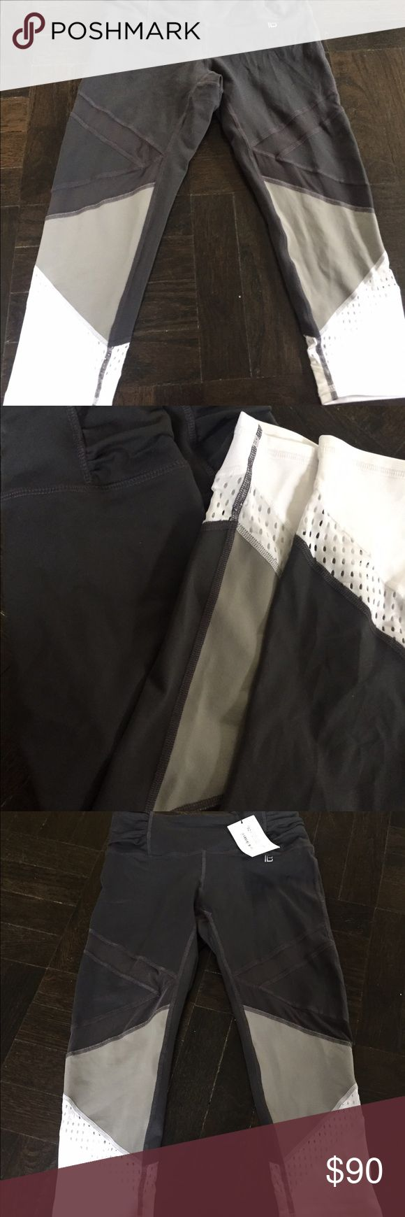Bandier Athletic Cropped Leggings - Sz. L!!! Bandier Gray Athletic Leggings in Size L. Dark Gray, Light Gray, and White geometric pattern. White mesh on bottom portion. Absolutely awesome leggings that you will get tons of compliments in!!! Bandier Pants Leggings