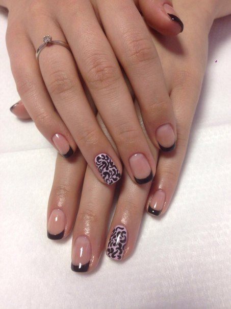 French is popular among women and is quite common. This version of the French manicure is very original and stands out among the others. A neat black French and gentle wavy abstraction on a ring finger is a perfect choice for casual manicure. This manicure looks favourably with any outfit.
