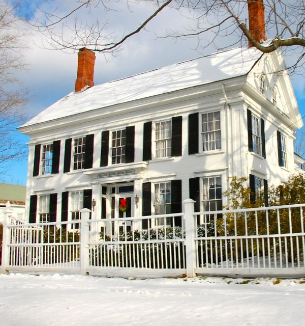 white picket fence, black shutters, red door would be perfect - new england home in the winter.