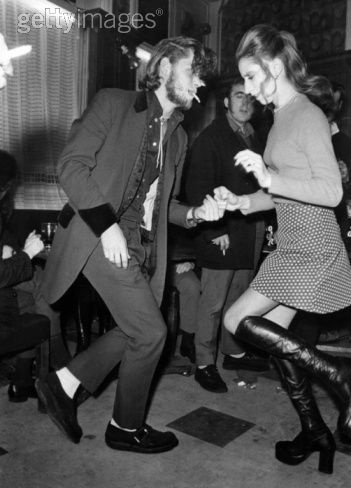 A Teddy boy and a young woman jiving at the Black Raven club in...