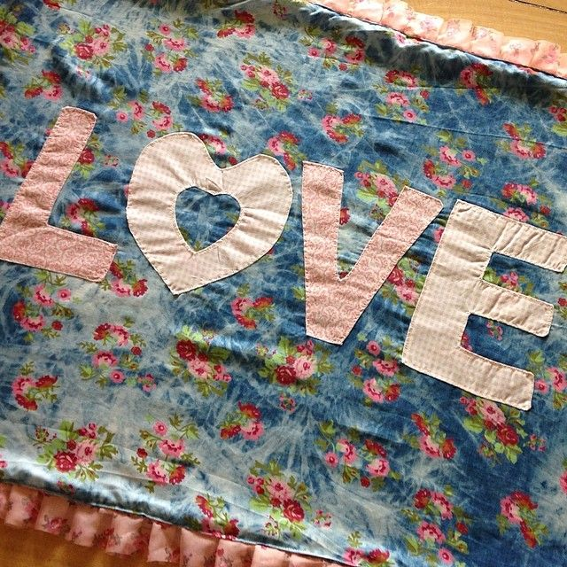 LOVE Baby Blanket. A special place for a new baby to rest on... Apricot minky material backing, soft denim floral front, and pretty floral ruffle. LOVE LOVE LOVE!