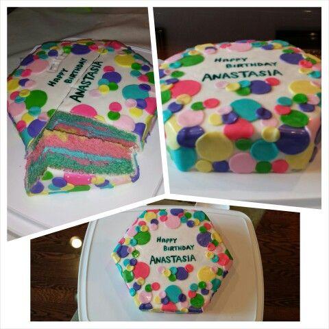 Anna's cake creations!   Fun rainbow polka-dot design with multi colored cake inside!