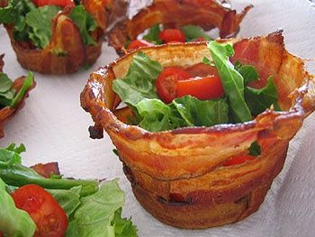 Bacon cups    --We have stumbled upon something bigger than life! Breadless BLT's! Mold the bacon onto that backs of muffin tins...bake until crisp and fill with arugula and cherry tomatoes and be the STAR of your party, brunch, shower, or whatever:) Bacon=heaven!!!!!! oink.