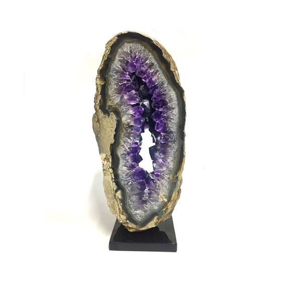 Uruguayan Amethyst is a rare, deep purple gemstone from Artigas in northern Uruguay. Uruguayan Amethyst is coveted for its spectacular beauty and is highly valued du to its rich color,  The piece is mounted on a black marble base.  The over all dimension are 4 L x 3W x 9.25 H