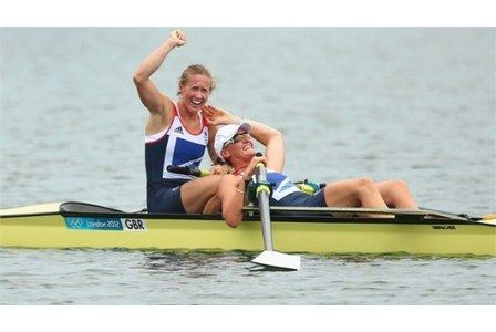 Heather Stanning and Helen Glover celebrate after winning gold