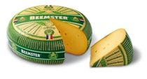 Beemster Graskaas is a very special and seasonal cheese produced only in the summer season. This unique cheese is made only from the milk of the Beemster cows, which are fed on the young spring fodder. Milk, taken during this specific period, is the creamiest milk of the year, which accords the cheese a rich and creamy consistency along with a deep flavor. Beemster Graskaas is medium firm in texture with a green inedible rind. It is matured for one-month before being sold in the market.