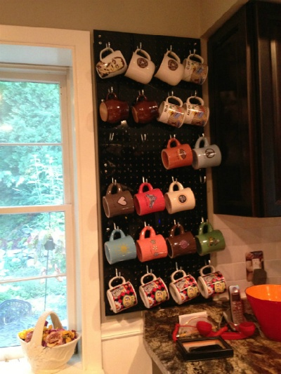Mug Display made from peg board... Decorative and a great cabinet space saver!