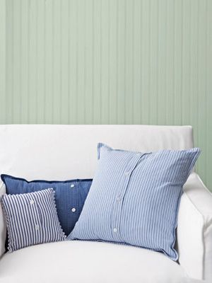 Recycle past-their-prime button-down shirts into pillow covers. #diy #crafts