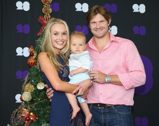 Australian Cricket Players Celebrate Christmas. Shane Watson of Australia poses with his wife Lee Watson and son Will ahead of the Cricket Australia Christmas Day Lunch at Crown Metropol on December 25, 2013 in Melbourne, Australia.
