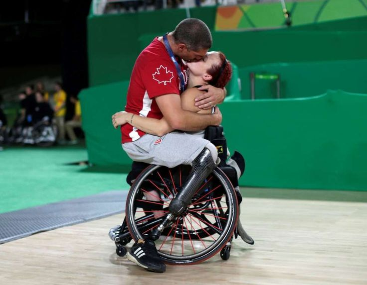 Canada's men's wheelchair basketball team player Adam Lancia embraces his wife Jamey Jewells of Cana... - REUTERS/Ueslei Marcelino