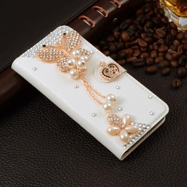 Compatible iPhone Model: iPhone 6 Plus,iPhone 6s,iPhone 5s,iPhone 6s plus,iphone 7 Plus,iPhone 6,iphone 7,iPhone SE,iPhone 5  Size: 4.0 inch / 4.7inch / 5.5 inch  Function: Dirt-resistant  Retail Package: No  Type: Rhinestone Case  Compatible Brand: Apple iPhones  Brand Name: AXBETY  Feature 1: Custom Crystal Rhinestone Diamond Wallet Case  Feature 3: rose flower butterfly lovely cross eiffel tower crown Ballet high heel  Model Number 1: For Fundas apple iphone 7 Plus 7plus case Giltter…