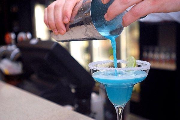 This Blue Sourworm Cocktail is a beautiful blend of Alize Bleu, Vodka, Lemon & Apple Juice.