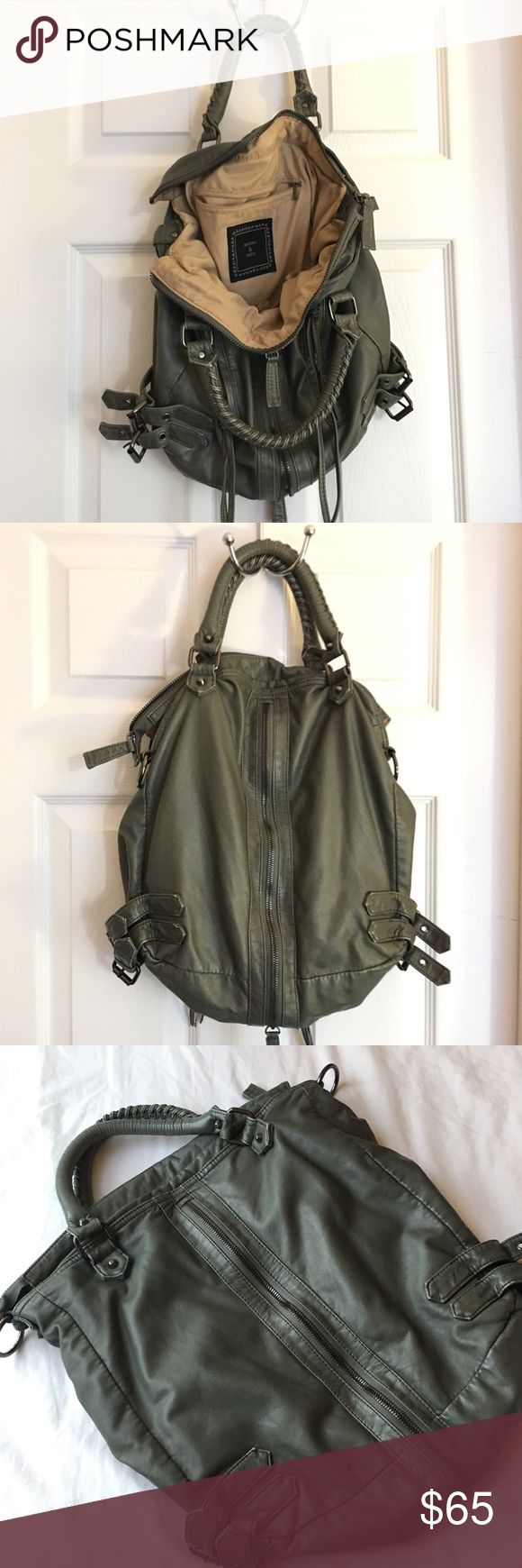 Urban Outfitters Deena & Ozzy Leather Bag Urban Outfitters Deena & Ozzy Leather Bag in Grayish Green. Great bag with fun zipper all the way around lengthwise. Several interior pockets. Zippered outer pockets. Interior has some staining in the very bottom (pen marks mostly). Deena & Ozzy Bags