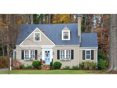 Taupe with black shutters and blue door