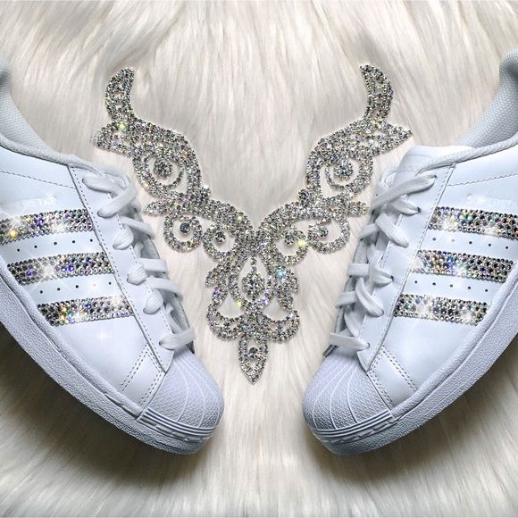 Swarovski Adidas Superstar Shoes - Bling Adidas Authentic Adidas Superstar Shoes In White (Order 1/2 size smaller than normal).  Outer Stripes Are Customized With HUNDREDS Of The Most Expensive SWAROVSKI® Crystals In The World. Our Crystals Feature X-Cut Technology For Diamond-Like Brilliance And Shine.  Brand new in original box, purchased directly from an authorized Adidas retailer.  Crystals have been applied with industrial strength glue. Will never come off.  For better pricing and more…