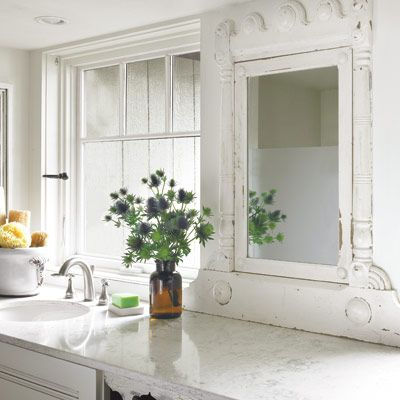 A salvaged dresser mirror adds vintage character to this bath. | Photo: Nathan Kirkman | thisoldhouse.com