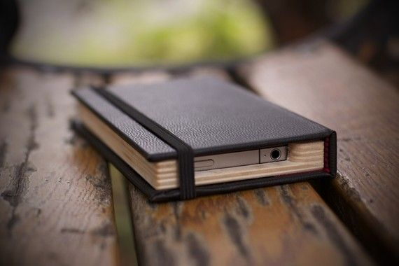 The Original Little Black Book for the iPhone 4/4S (See our Newest version on other listings). $29.99, via Etsy.