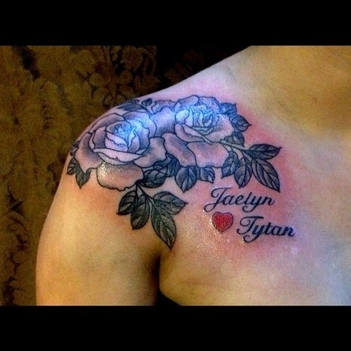 Roses with Kids Names on Womans Shoulder Tattoo by John Wilson #Tattoos #roses #kidsnames tattoopics.org/...