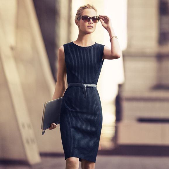 Pinstripe sheath pencil dress. Belted at the waist for a fitted career business outfit.