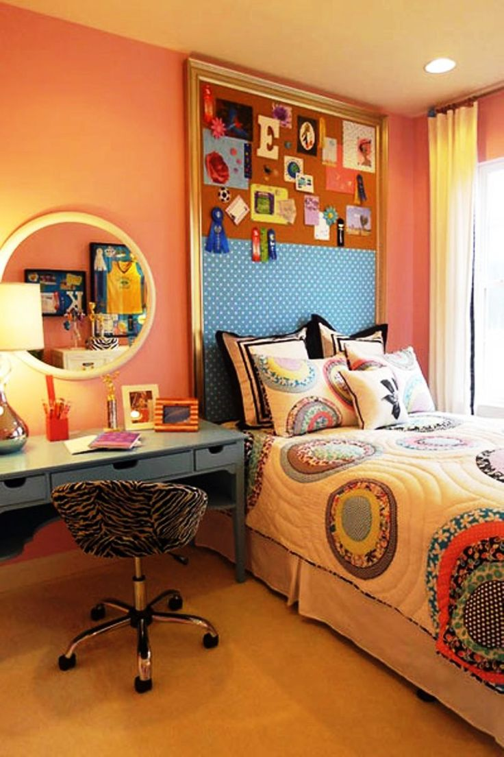 Covered cork boards instead of headboards for the girls would allow them each to have a space to decorateat their whim, but the boards themselves can coordinate with eachother.
