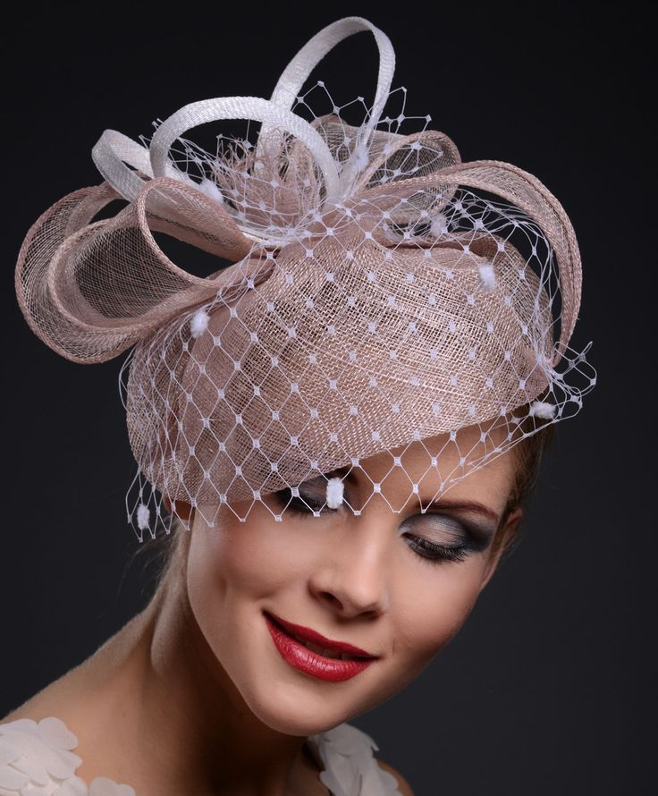 Pink fascinator with spot veiling, cocktail hat, Ascot hat, wedding hat