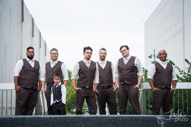 Custom made slim pants paired with matching fitted vests , ivory dress shirts and striped earthtone ties . #romantic #fun #rustic #dezziandshimonswedding