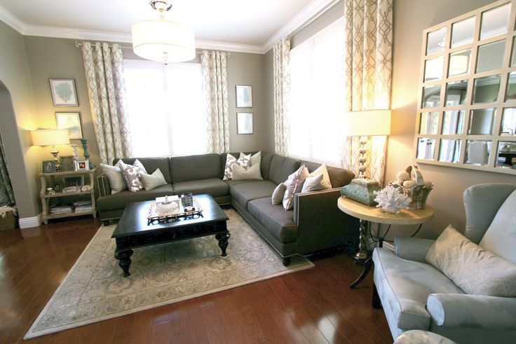 transitional living room. braemore trellis curtains. aqua coral art. taupe wall paint. custom media cabinet. drum pendant.