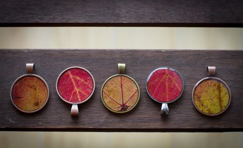 cool idea for diy jewelry: preserving the things you love in resin!