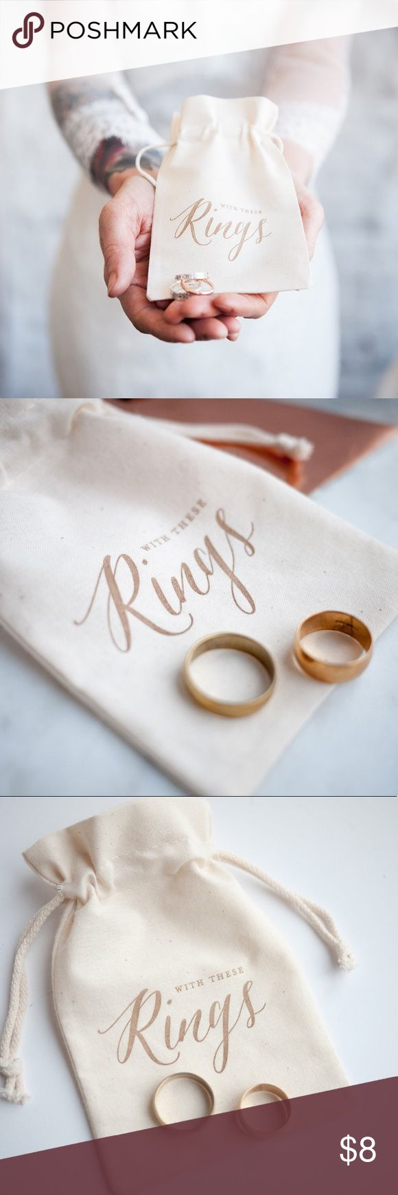 """Gold Calligraphy Wedding Ring Bag, ring pillow alt Handmade item. Materials: natural cotton, linen, letterpress. Perfect for the rustic Autumn or Fall wedding. This bag is an idea alternative to a ring pillow or the perfect size for the best man to pop in his pocket and and keep your wedding rings safe.  Size approx: 10cm(W) x 15cm (H) = 3.9"""" x 5.9""""  Easy to keep closed and to open, no fumbling around at the alter. Good size will fit snuggly in a breast or pants pocket. Makes a lovely…"""