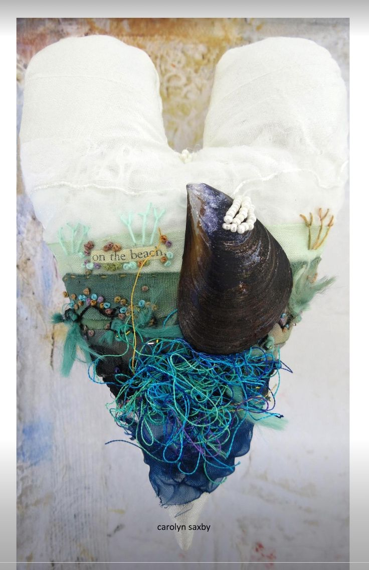 """""""on the beach"""" - seaside fibre heart on white silk with hand stitching and a dark blue mussel shell - textiles - beading - http://carolynsaxby.blogspot.co.uk"""
