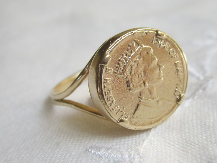 Gold coin ring.  I'd love to have one similar.  Pinkie ring.