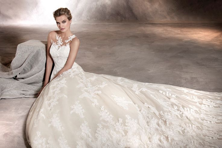 ANGELICA - The lace and floral details create this wedding dress with a sweetheart neckline. Tulle and appliqués run throughout the entire dress seemingly melting into the skin