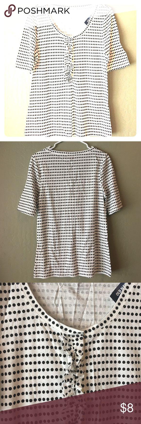 NWT Old Navy White/Black Polka Dot Tee T Shirt New with tags classic styled white w/ black polka dots three-quarter sleeve Old Navy T-shirt. Women's size Large. Ruffle detail down front buttons. See photos for fabric blend. Thanks for looking! Old Navy Tops Tees - Short Sleeve