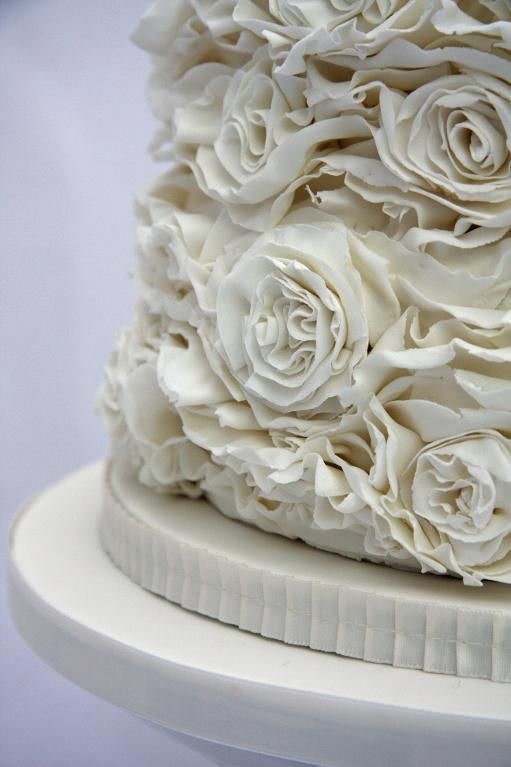 Roses & Ruffles Wedding Cake 7 teirs, multiple cake fillings, rainbow filling in pastel colours, red velvet and vanilla,