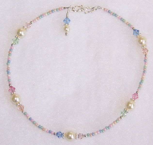 """""""Sugar Cookie"""" handmade beaded anklet.....Swarovski """"cream"""" crystal pearls, Swarovski """"lt.sapphire, silk, peach, lt.rose, crysocholla"""" crystals, pastel mix glass seed beads, sterling silver Bali spacers, sterling silver beads and findings, and a sterling silver """"S"""" clasp."""