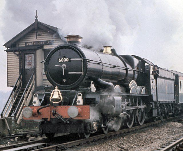 "The Kings bowed out during 1962 but unlike the Castles never suffered the indignity of relegation to menial jobs: and as soon as 1971 locomotive 6000 ""King George V"" returned to steam on British Rail metals.  Working out of Swindon on the final leg of a round tour with the Bulmer's Pullman train that 7 October, ""King George V"" - seen above passing North Pole Junction, West London and the lens of Michael A. Morant"