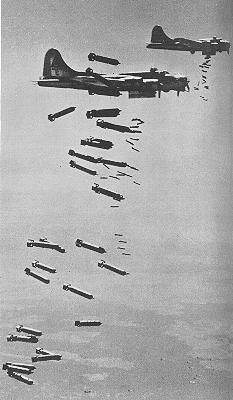 The organised formation of the bomber planes high above ground are a completely different picture to the fire and confusion going on where the bombs hit and this is a very good example of order and disorder in war.