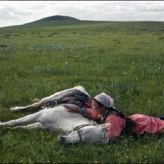 Photograph by Eve Arnold. Horse training in the army. Inner Mongolia. 1979.