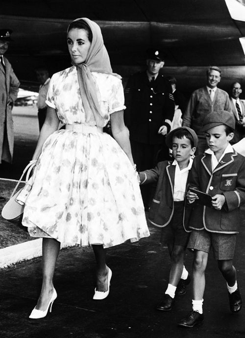 vintagegal:  Elizabeth Taylor and her children, Christopher and Michael Wilding, arrive at London Airport,1959