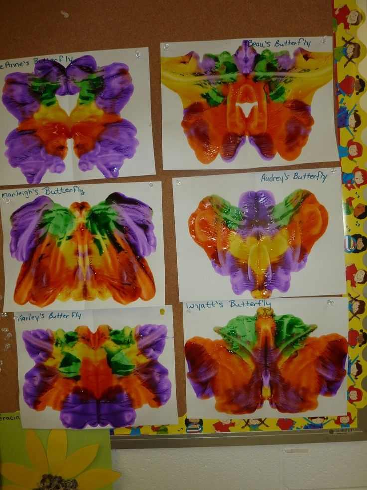 "pressed butterfly art along with ""the very hungry caterpillar"" book"